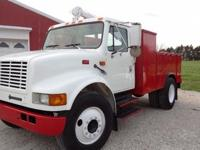 97 INT service truck with boom and air compressor DT466