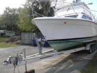 A perfect project boat that needs work. The engines