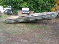 Boat camo'd for hunting, has oars Thanks  Location: