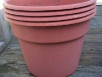 I HAVE FOR SALE (4) USED COLOR POT PLANTERS TERRA COTTA