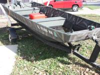 This is a 14' Flat Bottom boat with trailer and Johnson
