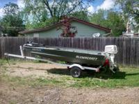 14' extra wide modified V and trailer 25 HP evinrude