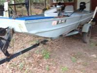 14 ft jon boat with a 15 HP Mercury pull start motor.