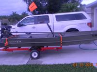 14 FT TRACKER BOAT WITH SWAMP RUNNER MUD MOTOR