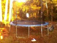Almost brand new 14 ft trampoline. Paid $300 for it in