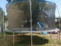 14 feet Trampoline. Frame, springs, jumping mat in good