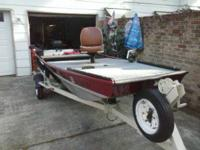 14' BASS WATERCRAFT WITH NEW CARPETING. 10 HORSE POWER