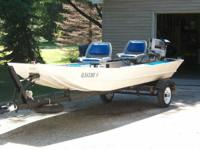 Monark 14' aluminum jon boat and trailer for sale.  The