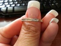 I am selling a 14 K White Gold Wedding Band with 1/2