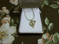 I have a ladies 14K yellow gold heart pendent with 10