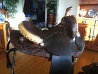 "This is a pre-owned 14"" Martha Josey barrel saddle is"