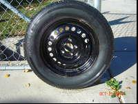 "14"" Mounted Tire. This Tire is mounted on a 5/Lug Good"