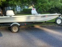 14' Randal Craft fiberglass skiff with 15hp Evinrude.