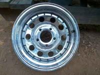 never used, 14 x 7 bullet hole style, 5 lug, chevy