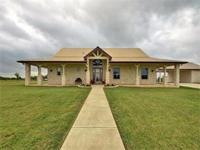Custom home on beautiful acreage w/open floorplan, open