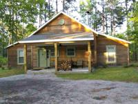 What a rare find! Remarkable cypress cabin on 85 acre