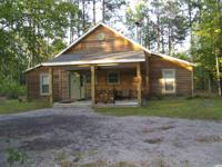 Remarkable cypress cabin and 85 acres in Williamsburg