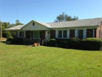 EASTOVER-Well-maintained brick home on 32+ acres. Home