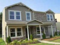 This builder model home has a stacked stone front with