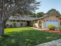 Located in the heart of desirable Laurelwood, this