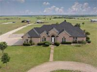 Wide open spaces and steed ready, this 20-acre home