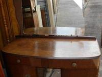 - $149--The dresser has a large flat surface, 2 top