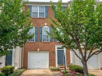 Gorgeous brick front townhome with a one-car garage.