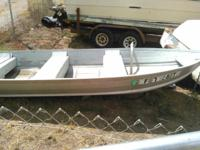 Aluminum skiff with 18 horse power Mercury motor 1200