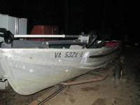 OLDER MODEL BOAT IN GOOD SHAPE WITH TRAILER. EVINRUDE