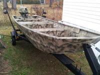 A 1975, 14ft Duracraft aluminum boat with a fresh camo