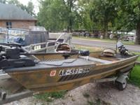 14ft Jon Boat 51-16 with 9.8 Mercury and trailer. Short