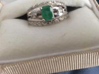 14Kt WG ring with a .61ct Colombian Emerald. The stone