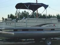 This 2005 Sun Tracker Fishing Barge is LIKE NEW, with a