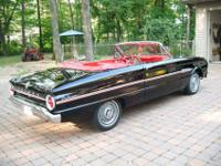 Here is a beauty of a classic car. Sleek black with