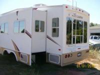 Triumph 2002 5th wheel 32', 2 slide outs. All you would