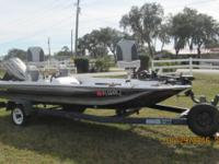 15' 1984 Bass boat, Evinrude 50 HP motor, trailer and