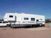 2004 37' Forest River Toy Hauler. It has dual popouts,