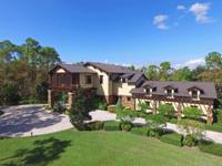 Private 15 acre custom designed home with top