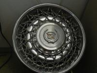 "We have a set of 15"" Cadillac Wire Wheel Covers for"