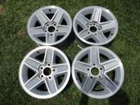 15 inch by 7 inch wide Chevy 5 spoke mags, extra clean,