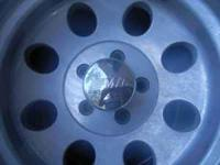 I have a used set of 4 Mickey Thompson wheels. I NO