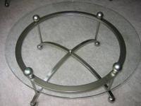 "Adjustable feet, quality glass 48"" Round glass top"