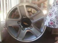 "I have a set of four 15"" chevrolet rims! Size: 15x7,"