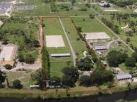 8.7 ACRE EQUESTRIAN PROPERTY, 3 BARNS W/A TOTAL OF 15