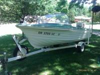 15 ' STEURY boat for sale with 33 hp Johnson motor.