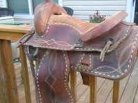 Nice used western saddle. Is scuffed and worn in some