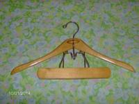All natural wood hangers in outstanding condition. A