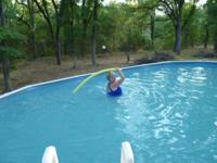 four feet deep, 15 x 30 ft above ground swimming pool
