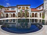 This 13,746 SF elegant, Mediterranean-style estate, is