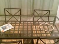 Glass top table with steel frame and 4 chairs with